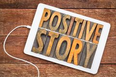 Positive story word abstract in wood type Stock Photos