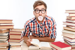Positive student studying in the library Stock Images