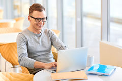 Positive student working on the laptop Royalty Free Stock Photography