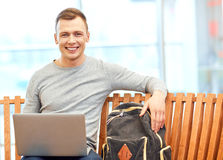 Positive student working on the laptop Stock Image
