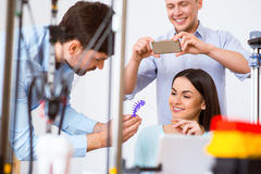 Positive students  using 3d printer Royalty Free Stock Photos
