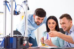 Positive students  using 3d printer Stock Photography