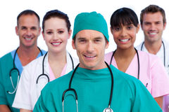 Positive surgeon and his medical team Stock Photo