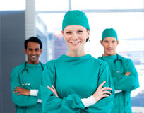Positive surgeons with folded arms standing Stock Image