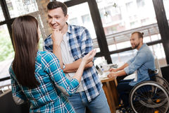 Positive talkative guy meeting his old friend Royalty Free Stock Image