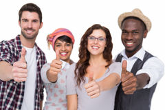 Positive teamwork smiling with thumbs up Royalty Free Stock Images