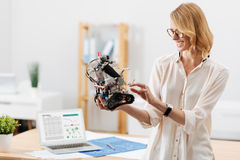 Positive technology specialist testing little robot indoors Royalty Free Stock Photo