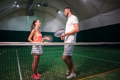 Positive tenis players having a nice conversation. Stock Images