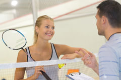 Positive tennis players chatting on court Stock Image