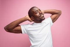 Positive thinking African-American man on pink background. Positive thinking African-American man isolated on pink background stock photo
