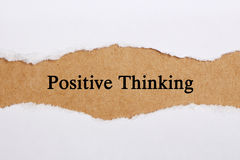 Positive Thinking. Concept on brown paper with teardrop stock photography