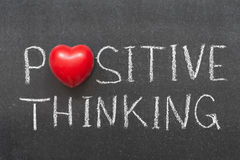 Positive thinking. Phrase handwritten on chalkboard with heart symbol instead of O Royalty Free Stock Images