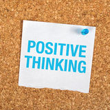 Positive Thinking. Reminder Note Message on Paper Pinned to a Cork Bulletin Board Royalty Free Stock Photography