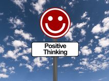 Positive thinking sign. With smiling face, blue sky and cloudscape background Stock Photography