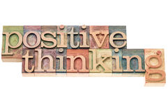 Positive thinking typography. Isolated text in letterpress wood type blocks Royalty Free Stock Photos