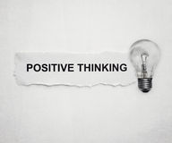 Positive thinking. Word on paper and light bulb Royalty Free Stock Images