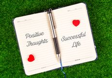 Positive thoughts equal successful life. Positive thoughts and successful life text on both sides of the notebook in the concept of equal Royalty Free Stock Image