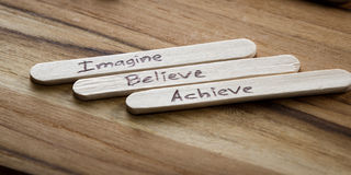 Positive thoughts for self esteem building. Close up of a hand written message on a popsicle stick as a self esteem building concept stock image