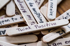 Positive thoughts for self esteem building. Close up of a hand written message on a popsicle stick as a self esteem building concept stock photos