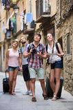 Positive tourists with camera and map Royalty Free Stock Photography