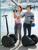Positive tourists couple relaxing near segways Royalty Free Stock Image