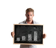 Positive trend. Businessman show positive trend in a blackboard Royalty Free Stock Images