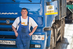 Positive truck driver stands near his Kamaz Royalty Free Stock Photos