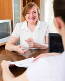 Positive woman answer questions Royalty Free Stock Image
