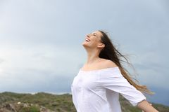Positive woman breathing enjoying the wind. Positive woman breathing fresh air enjoying the wind Royalty Free Stock Photography