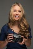 Positive woman with camera Stock Photos