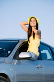 Positive woman on car travel Stock Photos