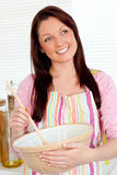 Positive woman cooking at home Royalty Free Stock Photo