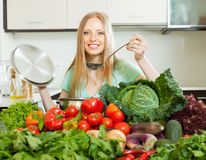 Positive woman cooking with soup ladle Royalty Free Stock Photos