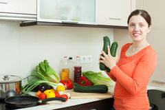 Positive woman cooking with squash Royalty Free Stock Images