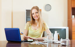 Positive woman counting the cost of medications Royalty Free Stock Photography