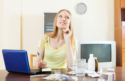 Positive woman counting the cost of treatment Stock Image