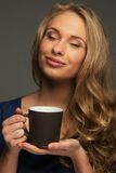 Positive woman with cup Royalty Free Stock Images