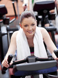 Positive woman doing exercises in a sport center Royalty Free Stock Photos