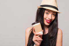 Positive woman drinking coffee. Magic beverage. Pleasant beautiful joyful woman holding coffee and going to drink it while expressing gladness stock images