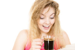 Positive woman drinking her morning coffee Royalty Free Stock Photos