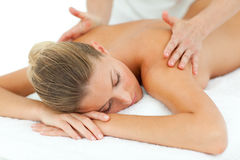 Positive woman enjoying a massage Stock Images