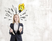 Positive woman, exclamations and a light bulb Royalty Free Stock Images