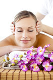 Positive woman having a head massage Stock Photo