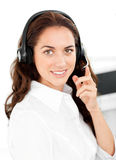 Positive woman with headset in a call center Royalty Free Stock Photo