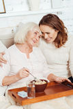 Positive woman and her smiling beautiful granddaughter embracing Royalty Free Stock Photo