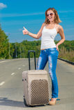 Positive woman hiker with big suitcase Royalty Free Stock Image