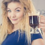 Positive woman drinking her morning coffee stock photos