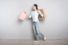 Positive woman holding packages Stock Image