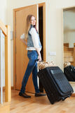 Positive woman in jeans  leaving the home Royalty Free Stock Photo