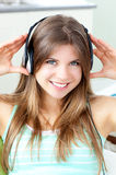 Positive woman listening to music with headphones Stock Images